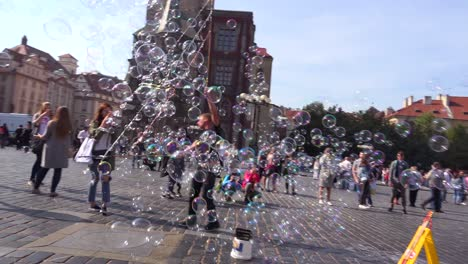 A-street-performer-blows-giant-bubbles-in-a-square-in-Prague-Czech-Republic