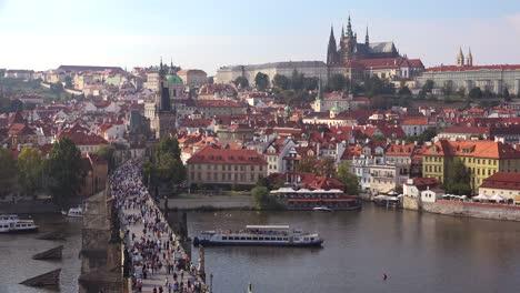 Beautiful-day-establishing-shot-crowds-crossing-the-Charles-Bridge-over-the-Vltava-River-in-Prague-Czech-Republic-1