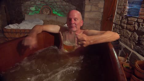 A-man-in-a-beer-spa-in-the-Czech-Republic-drinks-better-and-pours-the-rest-on-his-head