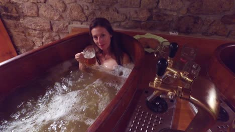 A-woman-in-a-beer-spa-toasts-from-a-tub-of-boiling-beer-2