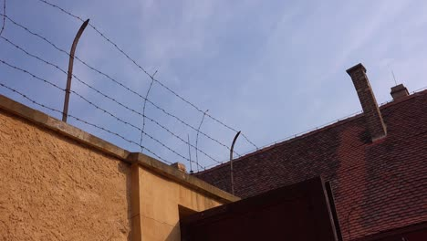 Barbed-wire-atop-high-walls-at-the-Terezin-Nazi-concentration-camp-in-Czech-Republic