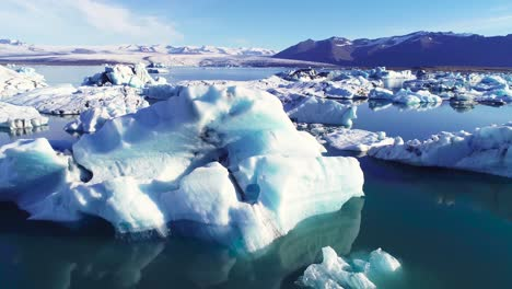 Beautiful-aerial-over-icebergs-in-the-Arctic-Jokulsarlon-glacier-lagoon-in-Iceland-9