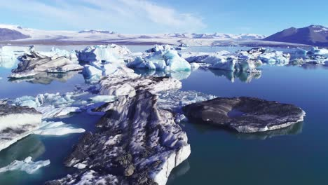 Beautiful-aerial-over-icebergs-in-the-Arctic-Jokulsarlon-glacier-lagoon-in-Iceland-12