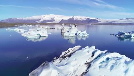 Beautiful-aerial-over-icebergs-in-the-Arctic-Jokulsarlon-glacier-lagoon-in-Iceland-15