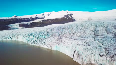 Slow-aerial-across-the-massive-glacier-lagoon-filled-with-icebergs-at-Fjallsarlon-Iceland-suggests-global-warming-and-climate-change-18