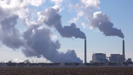 Huge-polluting-smokestacks-belch-CO2-into-the-atmosphere-suggest-pollution-carbon-emissions-and-global-warming