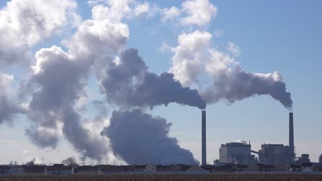 Huge-polluting-smokestacks-belch-CO2-into-the-atmosphere-suggest-pollution-carbon-emissions-and-global-warming-1