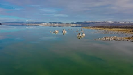Beautiful-and-inspiring-nature-drone-aerial-over-Mono-Lake-in-winter-with-perfect-reflection-tufa-outcropping-in-the-Eastern-Sierra-Nevada-mountains-in-California-2