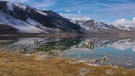 Beautiful-and-inspiring-nature-drone-aerial-over-Mono-Lake-in-winter-with-perfect-reflection-tufa-outcropping-in-the-Eastern-Sierra-Nevada-mountains-in-California-3