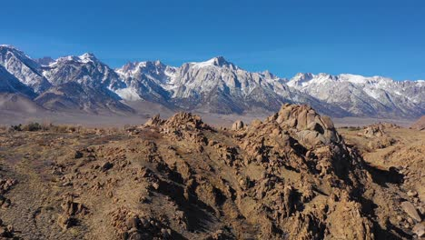 A-traveling-aerial-shot-reveals-the-snow-capped-Eastern-Sierra-Nevada-mountains-and-Mount-Whitney-in-snow-winter-near-Lone-Pine-California