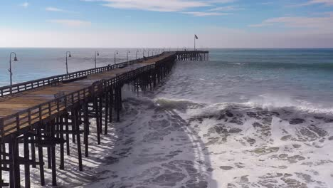 Aerial-over-huge-waves-rolling-in-over-a-California-pier-in-Ventura-California-during-a-big-winter-storm-suggests-global-warming-and-sea-level-rise-or-tsunami-4