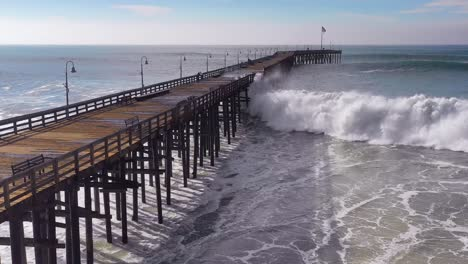 Aerial-over-huge-waves-rolling-in-over-a-California-pier-in-Ventura-California-during-a-big-winter-storm-suggests-global-warming-and-sea-level-rise-or-tsunami-5