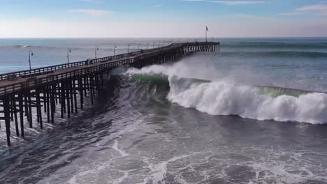 Aerial-over-huge-waves-rolling-in-over-a-California-pier-in-Ventura-California-during-a-big-winter-storm-suggests-global-warming-and-sea-level-rise-or-tsunami-6
