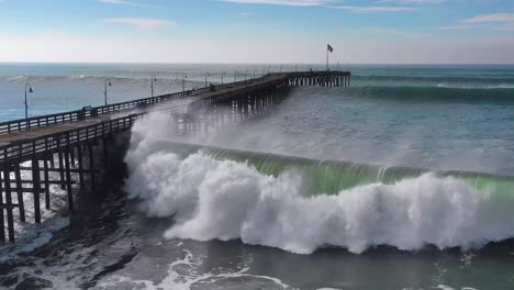 Aerial-over-huge-waves-rolling-in-over-a-California-pier-in-Ventura-California-during-a-big-winter-storm-suggests-global-warming-and-sea-level-rise-or-tsunami-7