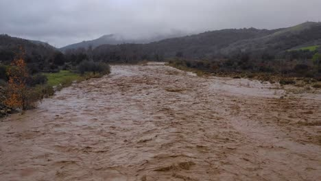 Aerial-of-flood-waters-moving-fast-down-the-Ventura-River-in-California-with-runoff-during-winter-weather-flooding-2