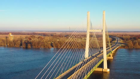 A-drone-aerial-of-a-bridge-over-the-Mississippi-River-at-Burlington-Iowa-suggesting-infrastructure-shipping-trucking-or-transportation