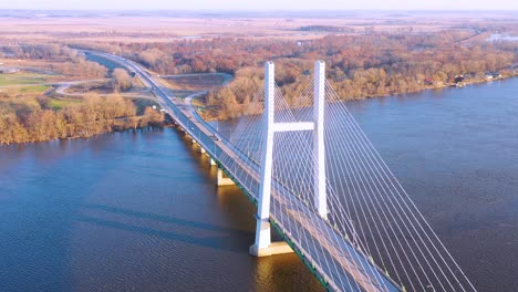 A-drone-aerial-of-trucks-crossing-a-bridge-over-the-Mississippi-River-at-Burlington-Iowa-suggesting-infrastructure-shipping-trucking-or-transportation-1