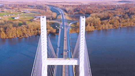 A-drone-aerial-of-cars-and-trucks-crossing-a-bridge-over-the-Mississippi-River-at-Burlington-Iowa-suggesting-infrastructure-shipping-trucking-or-transportation