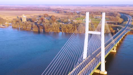 A-drone-aerial-of-cars-and-trucks-crossing-a-bridge-over-the-Mississippi-River-at-Burlington-Iowa-suggesting-infrastructure-shipping-trucking-or-transportation-2