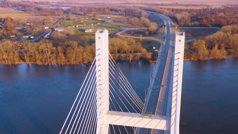 A-drone-aerial-of-cars-and-trucks-crossing-a-bridge-over-the-Mississippi-River-at-Burlington-Iowa-suggesting-infrastructure-shipping-trucking-or-transportation-3