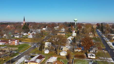A-drone-aerial-over-a-small-town-in-America-in-winter-snow-Riverside-Iowa-1