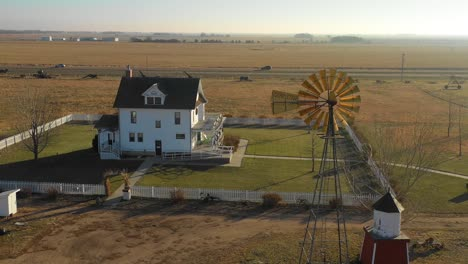 A-drone-aerial-establishing-shot-of-a-classic-farmhouse-farm-and-barns-in-rural-midwest-America-York-Nebraska-2