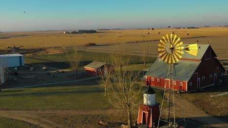 A-drone-aerial-establishing-shot-over-a-classic-beautiful-farmhouse-farm-and-barns-in-rural-midwest-America-York-Nebraska-1