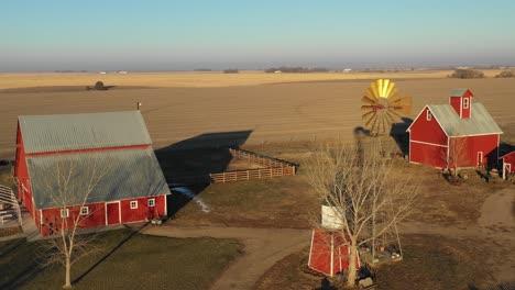 A-drone-aerial-establishing-shot-over-a-classic-beautiful-farmhouse-farm-and-barns-in-rural-midwest-America-York-Nebraska-2