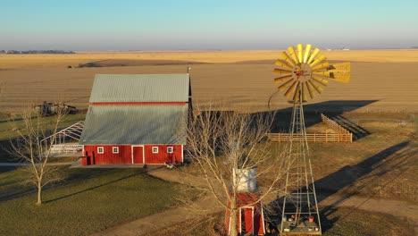 A-drone-aerial-establishing-shot-over-a-classic-beautiful-farmhouse-farm-and-barns-in-rural-midwest-America-York-Nebraska-3