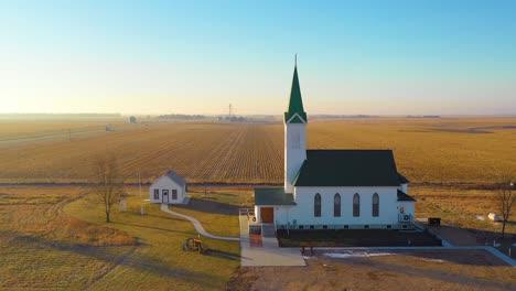 A-drone-aerial-establishing-shot-over-a-classic-beautiful-farmhouse-farm-and-barns-in-rural-midwest-America-York-Nebraska-5