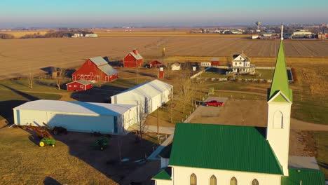 A-drone-aerial-establishing-shot-over-a-classic-beautiful-farmhouse-farm-and-barns-in-rural-midwest-America-York-Nebraska-6