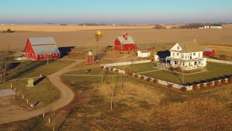 A-drone-aerial-establishing-shot-over-a-classic-beautiful-farmhouse-farm-and-barns-in-rural-midwest-America-York-Nebraska-7