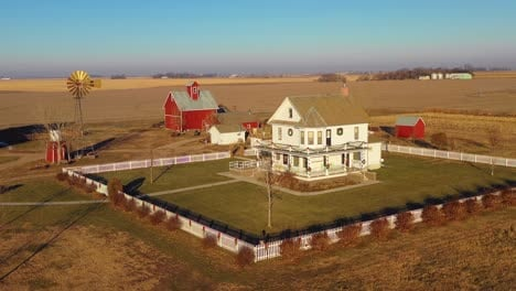 A-drone-aerial-establishing-shot-over-a-classic-beautiful-farmhouse-farm-and-barns-in-rural-midwest-America-York-Nebraska-8