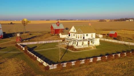 A-drone-aerial-establishing-shot-over-a-classic-beautiful-farmhouse-farm-and-barns-in-rural-midwest-America-York-Nebraska-9