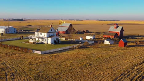 A-drone-aerial-establishing-shot-over-a-classic-beautiful-farmhouse-farm-and-barns-in-rural-midwest-America-York-Nebraska-10