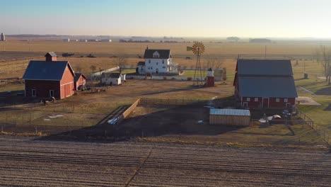 A-drone-aerial-establishing-shot-over-a-classic-beautiful-farmhouse-farm-and-barns-in-rural-midwest-America-York-Nebraska-11