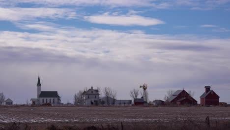 Establishing-shot-of-a-classic-beautiful-farmhouse-farm-and-barns-in-rural-midwest-America-York-Nebraska