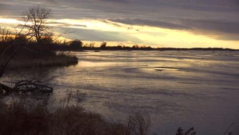 Establishing-shot-of-the-Platte-River-in-golden-light-in-central-Nebraska-near-Kearney