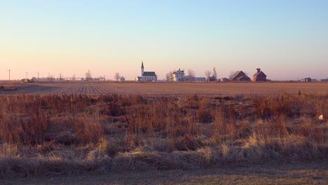 Establishing-shot-of-a-classic-beautiful-small-town-farmhouse-farm-and-barns-in-rural-midwest-America-York-Nebraska