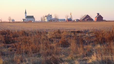 Establishing-shot-of-a-classic-beautiful-small-town-farmhouse-farm-and-barns-in-rural-midwest-America-York-Nebraska-1