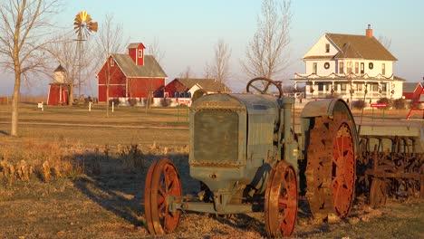 Establishing-shot-of-a-classic-beautiful-small-town-farmhouse-farm-tractor-and-barns-in-rural-midwest-America-York-Nebraska
