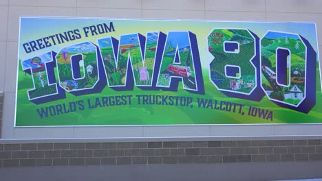 Sign-indicates-you-have-entered-Iowa-on-Interstate-80-at-the-World-s-largest-Truckstop-Wolcott