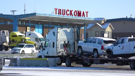 Trucks-are-stopped-in-the-snow-at-a-Truckomat-washing-station-and-truckstop