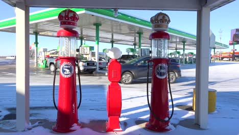 Old-gas-pumps-sit-beside-a-modern-gas-station-at-a-truck-stop-in-Iowa