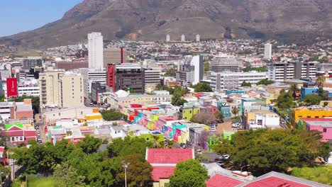 Aerial-over-colorful-Bo-kaap-Cape-Town-neighborhood-and-downtown-city-skyline-South-Africa
