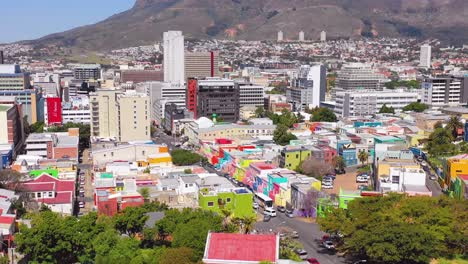 Aerial-over-colorful-Bo-kaap-Cape-Town-neighborhood-and-downtown-city-skyline-South-Africa-1