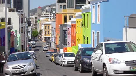 Establishing-shot-of-the-colorful-Bo-kaap-Malay-area-of-Cape-Town-South-Africa-with-colonial-buildings-and-traffic
