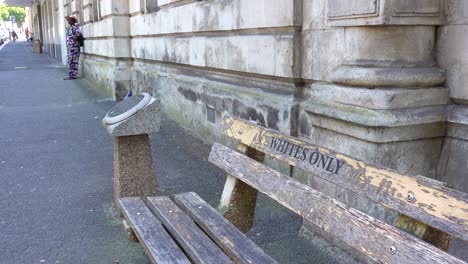 A-Bench-Saying-Whites-Only-on-a-Street-in-Cape-Town-South-Africa