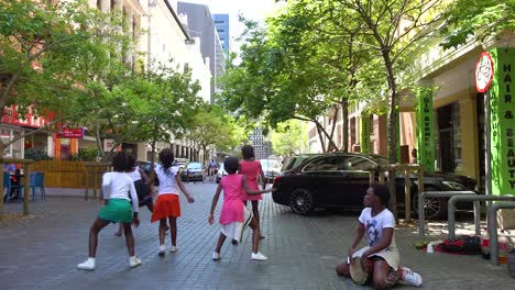 Young-black-children-dance-on-the-street-of-downtown-Cape-Town-South-Africa