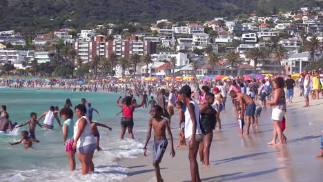 A-crowded-and-busy-holiday-beach-scene-at-Camps-Bay-Cape-Town-South-Africa-1